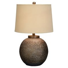 Next to the big chair.  Almas Table Lamp