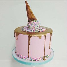 Whimsical gold drip cake with sprinkled ice cream on top - 10 Amazing Drip Cakes | Tinyme Blog