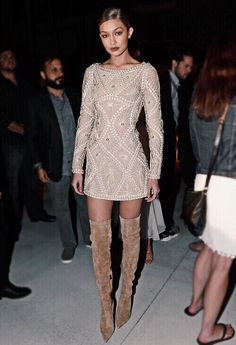 Loving the nude vibe going on here, it's all the way from the dress down to the knee high boots!! Xoxo F