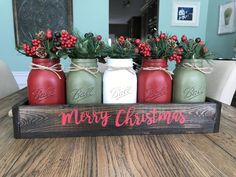 This piece will absolutely get you in the Christmas spirit! It has five quart size jars (2 red, 2 green, and 1 white), burlap handles, and an espresso box with