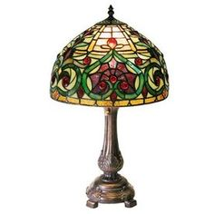 Add a classic look to any room in your home or office with this stained-glass Tiffany-style decorative table lamp. This attractive lamp is a colorful way to bring extra light into your space and has been handcrafted with 399 individual glass pieces. Red Table Lamp, Glass Table, Green Table, Lampe Art Deco, Tiffany Style Table Lamps, Petites Tables, Lamp Shade Store, Lamp Bases, Decoration