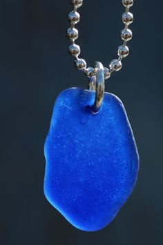 I could dive into this blue sea glass pendant.