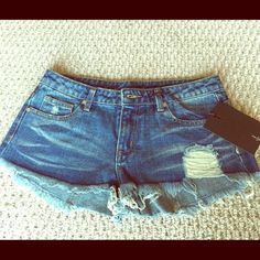 UNIF andie shorts brand new, sealed and never worn. cut off denim shorts in a medium blue wash with distressed detailing and raw, frayed edges. a classic five-pocket style with single button closure and zip fly. may fit size 27 better. 100% cotton. UNIF Shorts Jean Shorts