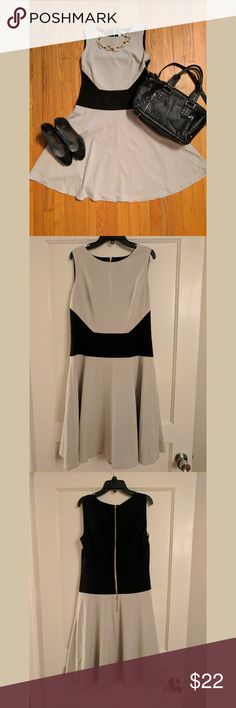 Calvin Klein Flowing Dress Wonderful dress for the office.   Great condition.  Shoes and bag available in my closet. Calvin Klein Dresses Midi