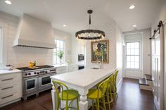 Instead of the expected tile backsplash, wood shiplap paneling was installed as a homage to the home's heritage. It was then painted with an oil-based paint meant for interior trim.