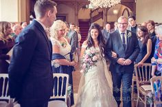 Father walks bride down the aisle at Froyle Park wedding photographs. Photography by one thousand words wedding photographers