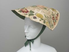 Hat with applique embroidery French, 18th century,  From: MFA, (Museum of Fine Arts) Boston, MA. Hat with applique embroidery, White satin round disk-like hat with crown only slightly raised. Rose and bud in center of crown, wreath of variety of flowers on brim; polychrome design in appliqué of silk, satin, velvet and ribbon; lined with green silk twill.