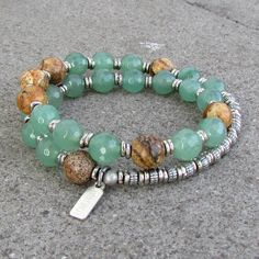 Light green faceted aventurine paired with jasper to create this 27 bead wrap mala bracelet stringed on hitec elastic cording for comfort and hand made African trade beads for sizing Aventurine provid