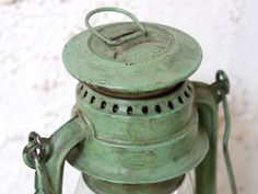 Original green vintage storm lanterns and lamps with a wonderful usd patina. Vsit our site today. Storm Lantern, Work Lamp, Rustic Lanterns, Retro Lighting, Shades Of Green, Country Style, Pantone, Color Splash, Light Colors