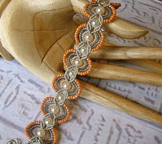 Handmade Micro macrame bracelet in peach, pearls and silver gray.. via Etsy.