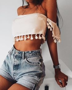 Cute off the shoulder cropped top with high waisted denim shorts.