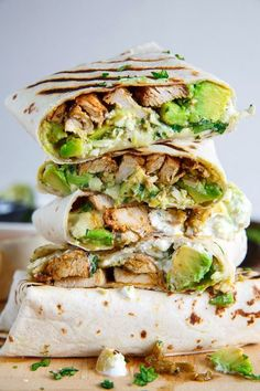 Chicken and Avocado Burritos | Burritos stuffed with juicy chicken, cool and creamy avocado, oozy gooey melted cheese, spicy salsa verde and sour cream!