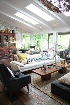 I like this bright eclectic living room, and the wallpaper is a nice surprise.
