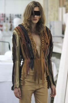 Margiela.  LOOK at that weaving, its just like the stuff you make with plastic lanyard for keychains!