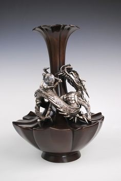 Japanese bronze vase with a silvered coiled dragon (tatsu)