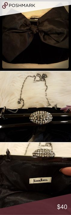 NEIMAN MARCUS EVENING CLUTCH W/BOW Super gorgeous and elegant.  NWOT. NO FLAWS. NEVER USED. See pic 4 for description! Size is 10 x 7. Holds cell phone and much more. Also has 48 inch silver chain to wear as crossbody or on your shoulder. Neiman Marcus Bags
