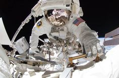 NASA astronaut Greg Chamitoff holds a handrail during the fourth and last spacewalk conducted by the shuttle Endeavour's crew at the International Space Station on May 27. Chamitoff and astronaut Michael Fincke (visible in the reflections from Chamitoff's helmet visor) transferred an inspection boom system, completing U.S. assembly of the station. The May 27 outing marked the last scheduled spacewalk to be conducted by a space shuttle crew.  (Photo: NASA TV via EPA)