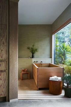 """She chose plywood for the Japanese-inspired main bathroom that was added downstairs and features a hinoki cedar tub and steam room. """"The bathroom looks like it's original, but it's not,"""" she says. """"In terms of what I designed for the house, it's my favourite part."""""""