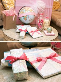 """Use Recycled Maps For Gift Wrap at a World Traveler Party: the pink """"Oh , the places she'll go"""" banner on the globe is ADORABLE!  {One Charming Party}"""