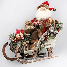 The Woodland Sled Santa from Karen Didion Originals brings the joy of Christmas into your home. The quality of this figurine is unmatched with its hand-painted face, glass inset eyes, real mohair beard, unique fabric, and detailed accessories.