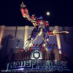 Optimus Prime stands watch over TRANSFORMERS: The Ride-3D N.E.S.T at Universal Studios Florida in the Universal Orlando Resort.