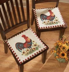"""Rooster Decor Chair Pad Cushions  In Our Catalog: 2PC Rooster Chair Cushions Availability: Backorder – Ships by 4/27/2012 Item #19073  $12.99 $9.99 You Save Up to 23%.  2pc Rooster Chair Cushions: Rooster cushions tie onto practically any chair; non-skid backing helps them stay in place.Cotton/polyester. Machine wash. Imported. 15""""Square."""