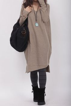 A long sweater is very simple, you can also wear as a skirt, the fabric is very comfortable for wearing stickers.