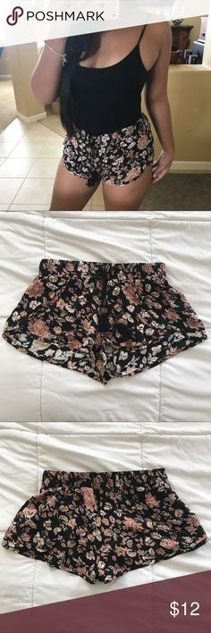 Adorable floral flowy Shorts Super cute black flowy shorts with an antique floral design. Adorable tassel detailing. Elastic waist band. Size small. Excellent condition Shorts