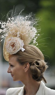 Horse Racing - Royal Ascot A female racegoer shows off her Ascot Hat