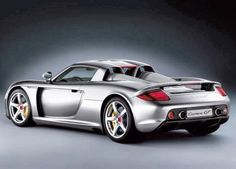Tiger Woods loves his Porsche Carrera GT. Pretty modest compared to some other Golfers cars. See why here: http://www.carhoots.com/blog/celebrity-cars/rickie-fowlers-new-66-mini-cooper-and-5-other-golfers-cars-photos