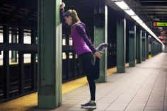 Stretching after evening run in the City - Cavan Images/Stone/Getty Images