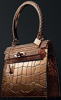 Designed by Hermes in collaboration with jeweler and shoe designer Pierre Hardy.Hermes Kelly is made out of solid rose gold dotted with a total of 1160 diamonds Bolso Birkin Hermes, Hermes Bags, Hermes Handbags, Purses And Handbags, Designer Handbags, Burberry Handbags, Hermes Purse, Gold Handbags, Handbags Online