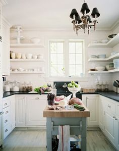 bright white kitchen with open shelving
