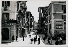 Via Vittorio Emanuele II si prepara a accogliere Benito Mussolini  nella sua visita a Chiavari in occasione dell'inaugurazione del Lido e della colonia Fara il 15 maggio 1938. (Photo: Edoardo Migone)#Chiavari #Riviera #Liguria #Ottocento #the1800s