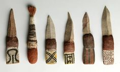 australianarchaeologyblog:    Central Australian decorated Stone Knives. Quartzite Stone Blade with Decorated Wooden Handle. Museum Victoria. These set of knives were produced by the Warumangu people (Tennant Creek) and collected by Baldwin Spencer in the early 1900s.
