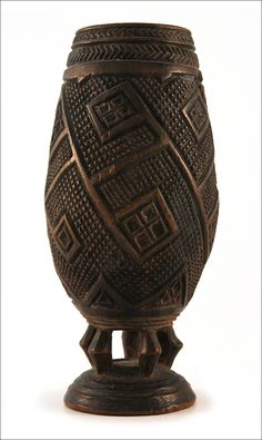 Palmwine cup, Kuba, D. R. Congo.   A Bakuba cup, of swelling circular form, supported on a domed base by five curving legs