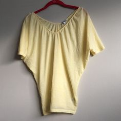 REDUCED! Express Yellow Shirt Yellow Express shirt! Really awesome, soft tee. I would keep this but it's too tight on me. The bottom is more fitted while the top is looser. You can wear this off the shoulder, that's how I wore it and it looks sooo cute! Really fun top, great for spring/summer. Like new condition! Only worn twice! Express Tops Tees - Short Sleeve