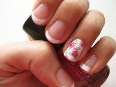 This is cute! With french solar nails and doing a flower design on one nail! I might have to try it.... Tori?