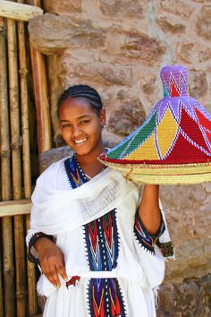 girl with a typical injera (local pancake) plate at a restaurant in Lalibela Ethiopia http://www.valerie-martin-photography.com/