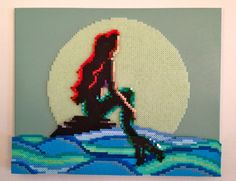 The Little Mermaid - Glow in the Dark (Perler Fuse beads on a painted canvas. 16x20 inches) -  Perler Bead Pixel Art by Kyle McCoy