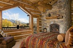 What a bedroom at the rustic cabin! That mountain view would never get old!