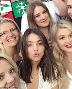 Spot the model: Miranda went on to share a group snap of herself and family members captioned, 'Family fun'