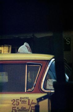 "SAUL LEITER - Taxi, c. 1960  I never thought of the urban environment as isolating,"" he says. ""I leave these speculations to others. It's quite possible that my work represents a search for beauty in the most prosaic and ordinary places. One doesn't have to be in some faraway dreamland in order to find beauty."""