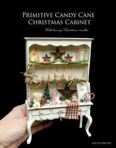 SALE was £349.99 - Primitive Candy Cane Christmas Cabinet  This wonderful piece it set in an artisan made cabinet, and comes with festive pine