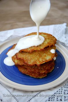 Potato pancakes are shallow-fried pancakes of grated or ground potato, flour and egg, often flavored with grated onion or garlic and seasoning. Potato pancakes may be topped with a variety of condiments, ranging from the savory (such as sour cream or cottage cheese) to the sweet (such as apple sauce or sugar), or they may be served ungarnished.