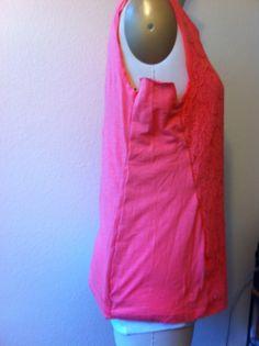 Enlarging a shirt using sleeves as extra fabric.
