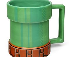 Power up your morning breakfast by enjoying a piping hot cup of coffee from the Super Mario pipe mug. This novelty ceramic mug holds up to 15 ounces of liquid and features a fun design that makes it appear as if an 8-bit tube is coming out from your table.