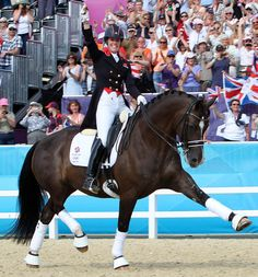 Charlotte Dujardin and Valegro celebrating their historic 2012 Olympic individual gold medal after leading Great Britain to team gold, the first dressage Olympic medal for the nation in 100 years of equestrian sports at the Games. © 2012 Ken Braddick/dressage-news.com