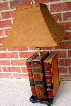 I've seen cute lamps made out of stacked books, but I love this lamp made out of upright antique books.