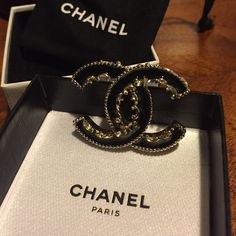 Goal Host Pick2015 Chanel black and gold lace This Chanel brooch is black enamel with gold lace trim. Mint condition. Stamped on back. Guaranteed Authentic, Approx 1 3/4 by 1 1/4 worn once. This item is gorgeous on! See photos and ask questions if needed. Thanks for visiting my closet! CHANEL Jewelry Brooches